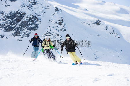 group of friends skiing on mountain