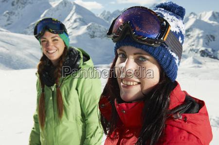 two women wearing knit hats in