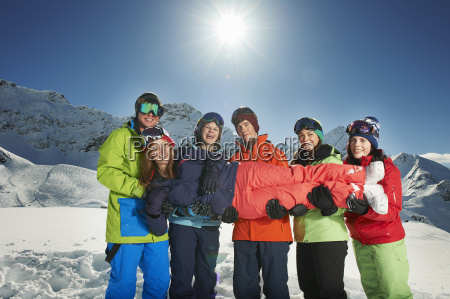 friends holding woman in snow kuhtai