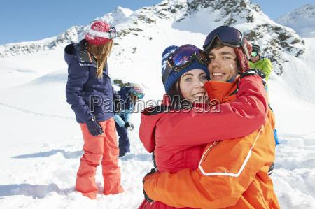 friends, wearing, skiwear, hugging, , kuhtai, , austria - 19512988