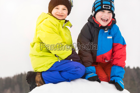 two boys wearing winter clothes