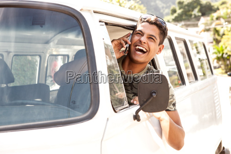 man in van talking on mobile