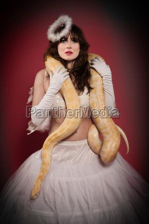 woman in angel costume wearing snake