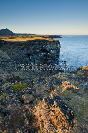 rocky cliff top and water