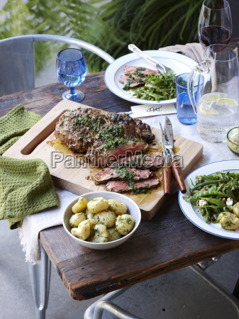 dinner table with barbecued herb crust