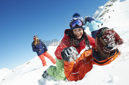 friends play fighting in snow kuhtai
