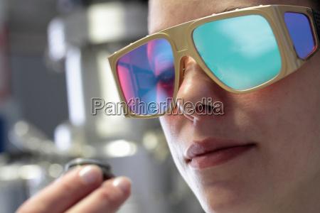 close up of female scientist examining