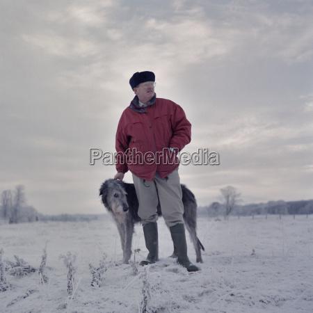 portrait of man with deerhound in