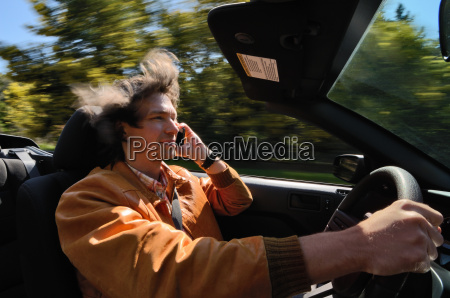 man driving and talking on cell