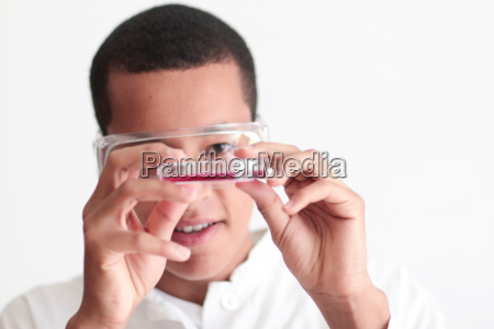 student holding dish in science lab