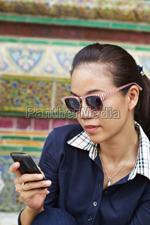 woman using cell phone at ornate