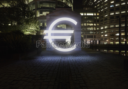 glowing euro symbol in city street