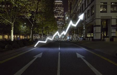glowing arrow symbol in city street