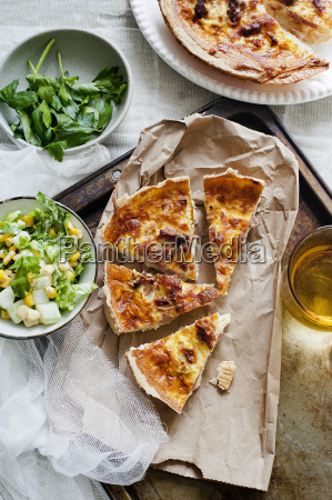 quiche lorraine with parsley and salad