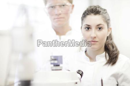 scientist using microscope in lab