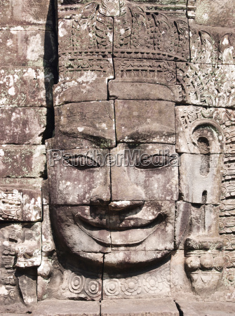 a stone face built into the