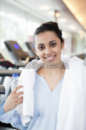 woman with towel and water bottle