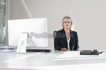 businesswoman at desk portrait