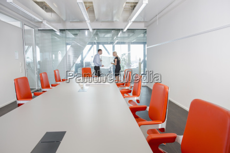 colleagues standing in conference room