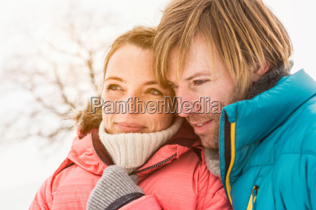 portrait of couple wearing winter coats
