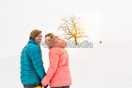 mid adult couple walking in snow