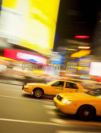 taxicabs in motion new york city