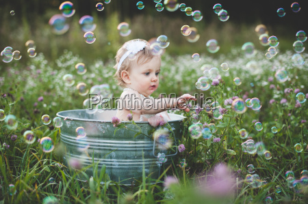 baby girl in tin bathtub in