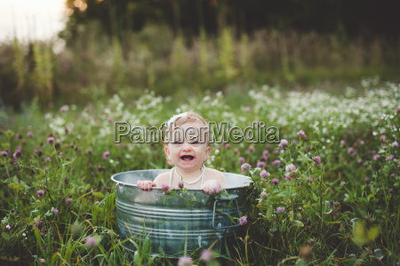 baby girl bathing in a tin
