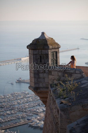 woman admiring view from castle