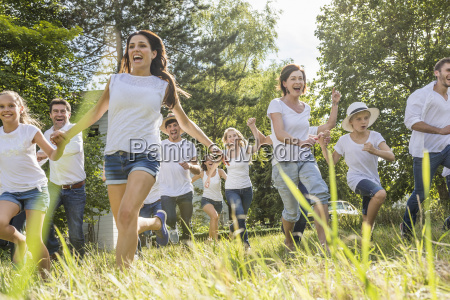 group, of, people, running, through, forest - 19522256