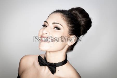 smiling woman wearing bow tie