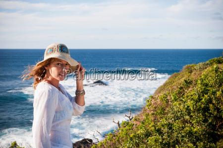 woman standing on coastal cliffs