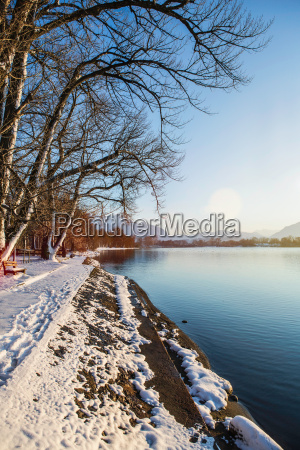 snowy bank and still rural lake