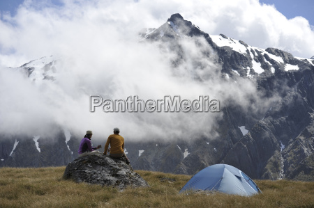 couple camping in mountains new zealand
