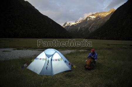 woman camping at dusk new zealand