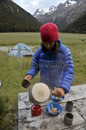 mid adult woman cooking food on