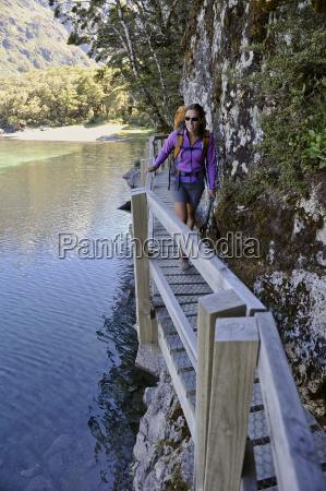 mid adult woman walking on boardwalk