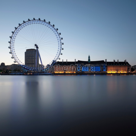 london eye and building by still