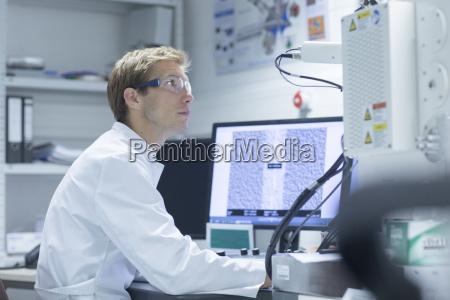 male scientist working with desktop computer