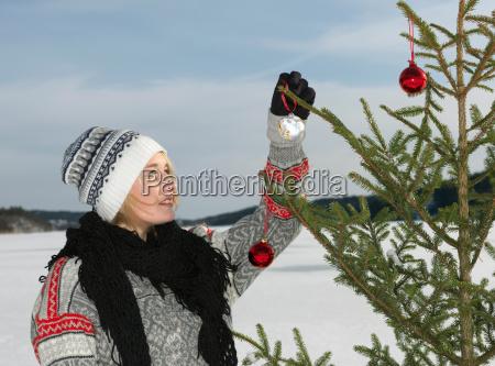 woman preparing christmas tree