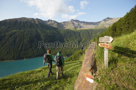 rear view of young couple hiking