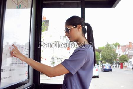 woman reading urban bus map