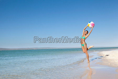 woman playing with beach ball in