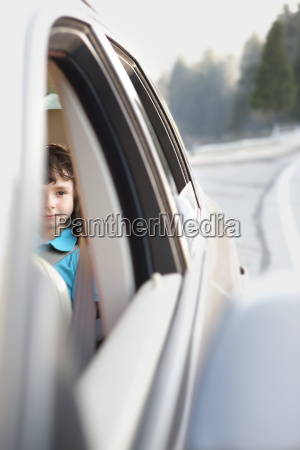 boy sitting in the back seat