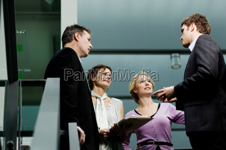 business partners discussing a file