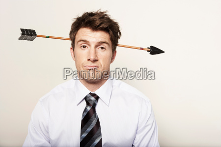 business man with arrow through head