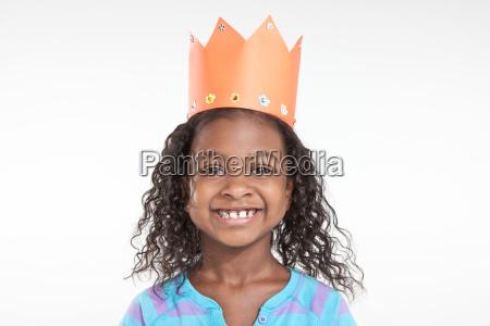 girl wearing orange paper crown