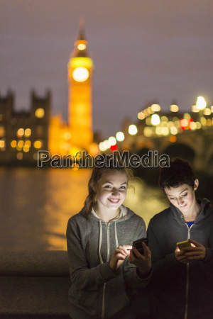 young women opposite palace of westminster