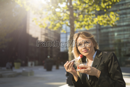 portrait of young businesswoman outside city