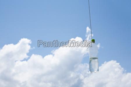 water bottle hanging on string